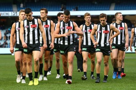 The defeated Magpies walk off the ground but coach Nathan Buckley still hopes for finals.