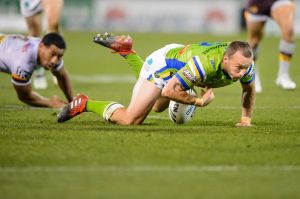 Raiders' Josh Hodgson loses the ball after being ankle tapped near the end of the first half.