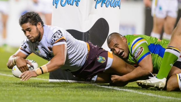 Broncos' Joe Ofahengaue hits the posts on the way to scoring a try against the Raiders.