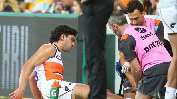 Tim Taranto receives treatment on the sidelines for a shin injury.