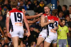 Demons defender Tom McDonald celebrates a late goal to steal the game from West Coast.