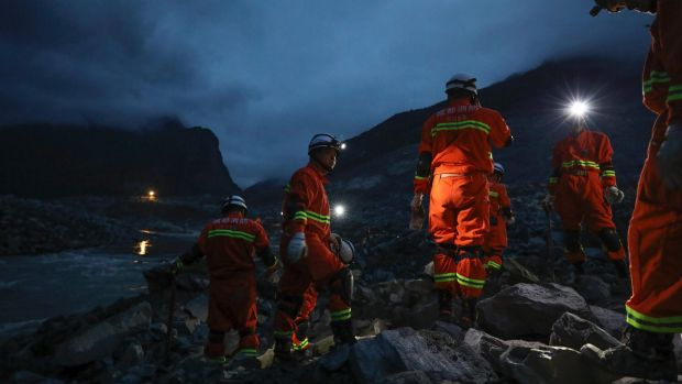 Scores missing in massive China landslide; 10 bodies found