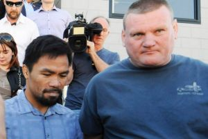 Gabriel's Horn: Boxer Manny Pacquiao with Promoter Deano Lonergan (right) leave Worship Centre Christian Church in ...
