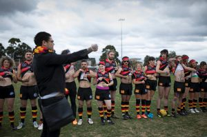 Dan Sultan, coach of the Rockdogs asks the team to lift their shirts in recognition of Aboriginal player Nicky Winmar ...