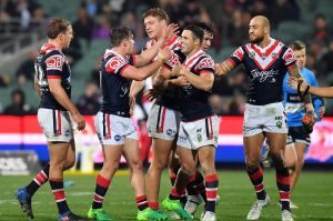 Happy (temporary) home: Roosters players celebrate in Adelaide.