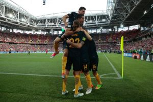 The Socceroos celebrate James Troisi's first-half goal.