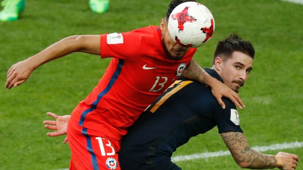 Chile's Paulo Cesar Diaz Huincales  challenges for the ball with Australia's Jamie Maclaren.