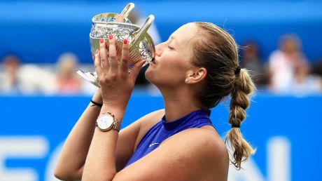 Hand it over: Petra Kvitova of the Czech Republic kisses the trophy after taking out the final against Ashleigh Barty, ...