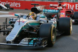 Fuel to the fire: Lewis Hamilton of Mercedes, with Ferrari driver Sebastian Vettel in tow - who appeared to ...