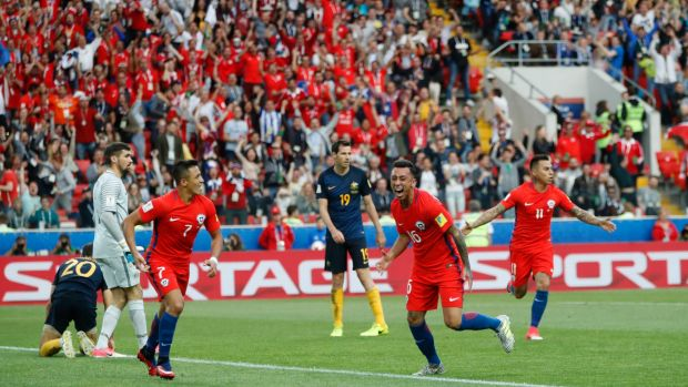 Chile's Martin Rodriguez (second right) celebrates after scoring the equaliser against Australia.