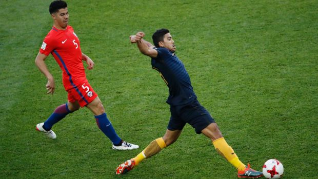 Australia's Massimo Corey Luongo (right) lunges to control the ball with Chile's Francisco Andres Silva Gajardo a step ...