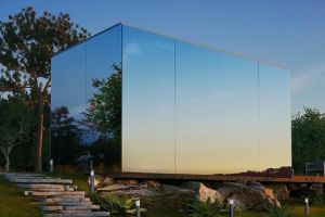Mirrored on three sides, this tiny house blends into the landscape so at times it is literally invisible.