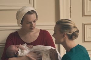 Offred (Elisabeth Moss, left) struggles to survive as a reproductive surrogate for a powerful Commander and his ...
