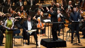 "French music specialist Charles Dutoit brought a ""refined translucency"" to the performance."