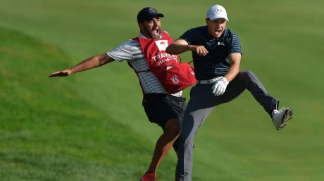 Master stroke: Jordan Spieth celebrates with caddie Michael Greller after Spieth holed a bunker shot on a playoff hole ...