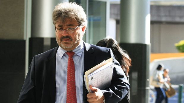 Barrister Sam Di Carlo leaves the Brisbane Magistrates Court on Monday after representing accused fraudster Hui Tian.