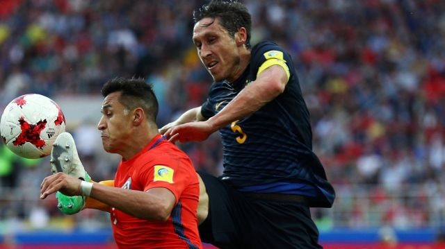 MOSCOW, RUSSIA - JUNE 25: Mark Milligan of Australia fouls Alexis Sanchez of Chile during the FIFA Confederations Cup ...