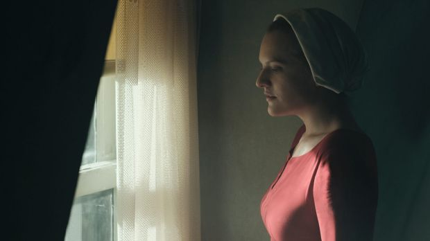 Elisabeth Moss as Offred in <i>The Handmaid's Tale</i>, which explains how easily manufactured fear can be used to ...
