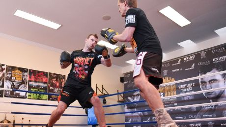 Jeff Horn (left) trains with Glenn Ruston during a training session in Brisbane, on Monday.