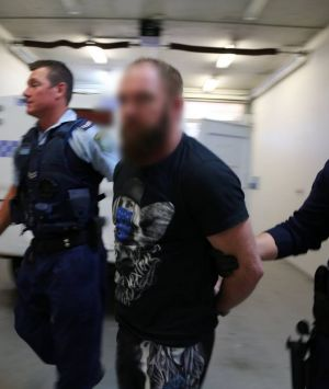 NSW Police arrest a man in Nelson Bay on Monday.