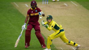 Australia wicketkeeper Alyssa Healy gloves a return during the opening World Cup match against the West Indies.