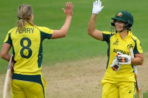 TAUNTON, ENGLAND - JUNE 26: Australia batsman Nicole Bolton (r) and Ellyse Perry celebrate victory during the ICC ...