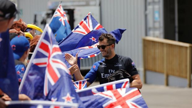 A Kiwi crew member from  greeting fans before the America's Cup sailing event on Monday.