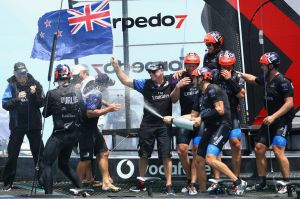 Emirates Team New Zealand helmed by Peter Burling celebrate after winning the America's Cup.