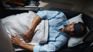 Sleeping on a plane is a struggle between technology and nature.