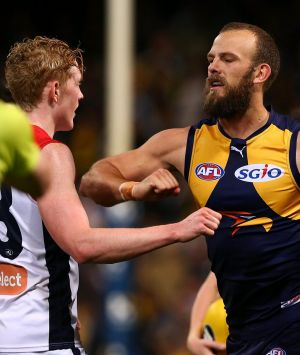 Will Schofield of the Eagles raises his forearm towards Clayton Oliver of the Demons at half time.