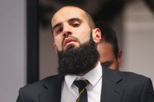 Richmond's Bachar Houli leaves the AFL tribunal after receiving a two-week suspension for striking Jed Lamb.