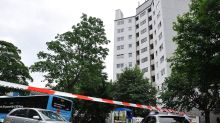German police block entry to an apartment block in Wuppertal, on Tuesday.