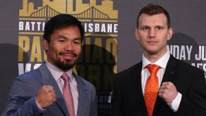 Niceties over: Manny Pacquiao and Jeff Horn face off at Suncorp Stadium on Wednesday.