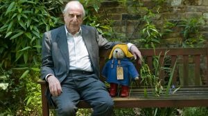 Michael Bond, pictured in 2005 with a Paddington Bear toy.