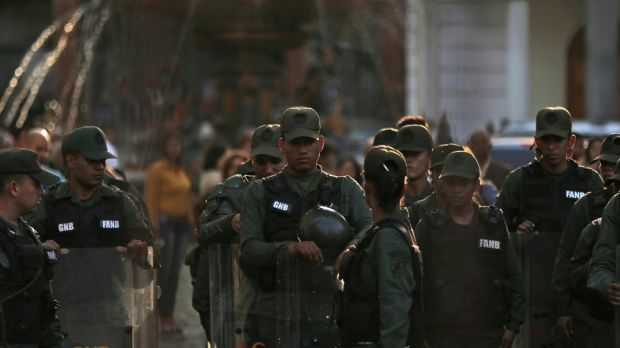 Venezuelan Bolivarian National Guard line up inside of National Assembly building in Caracas, Venezuela, on Tuesday.