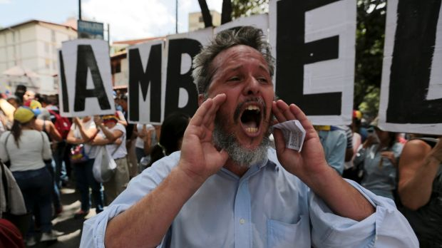 A man shouts slogans against Venezuela's President Nicolas Maduro's government during a protest also commemorating the ...
