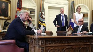 President Donald Trump speaks on the phone with Irish Prime Minister Leo Varadkar in the Oval Office of the White House.