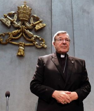 Cardinal George Pell arrives to make a statement, at the Vatican.