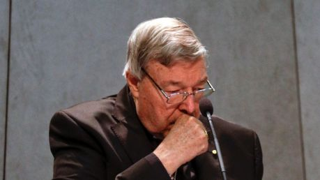 Cardinal George Pell makes a statement at the Vatican on Thursday.