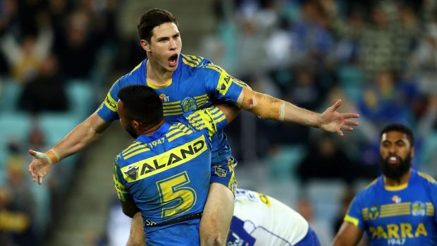 Hearts and minds: Mitch Moses celebrates after kicking the winning field goal in extra-time, winning over Parramatta ...
