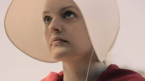 "Offred (Elisabeth Moss) in ""The Handmaid's Tale"", a dystopian world in which fertile women are enslaved as child breeders."