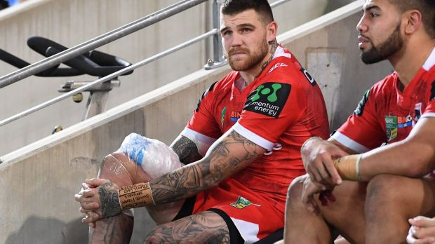 Scare: Josh Dugan ices his knee after coming off injured.