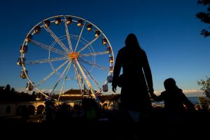 A mother takes her daughter to the newly installed ferris wheel at Bondi Beach for the Bondi Eye.