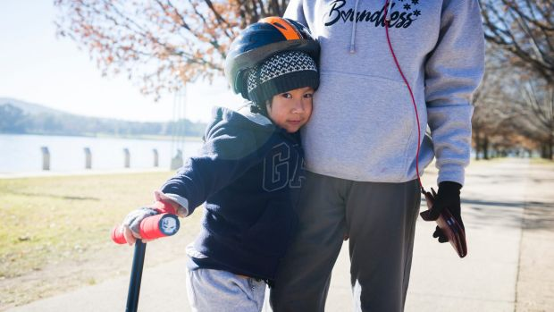 Bernard Majadas, 5, rugged up to brave the frosty Canberra morning on Saturday.