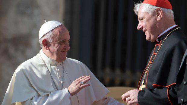 At odds: Pope Francis with Cardinal Gerhard Ludwig Mueller at the Vatican in 2014.