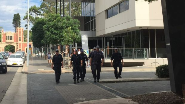Armed police officers leave Parramatta Children's Court following the February court appearance of two teenagers charged ...