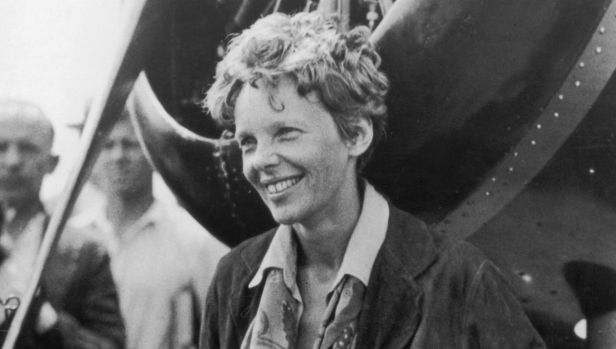 American aviatrix Amelia Earhart (1898 - 1937) exits her aircraft at Derry, Ireland, after her solo transatlantic ...