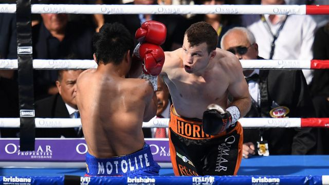 Man v mountain: Manny Pacquiao and Jeff Horn trade blows.