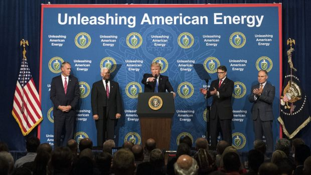 US President Donald Trump, centre, speaks during the Unleashing American Energy event at the Department of Energy,  as ...