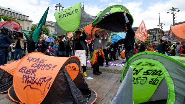 Participants of protest against the G20 summit demonstrate with tents for the construction of camps.